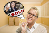 Woman in Empty Room with Thought Bubble of Sold Real Estate Sign — Stock Photo