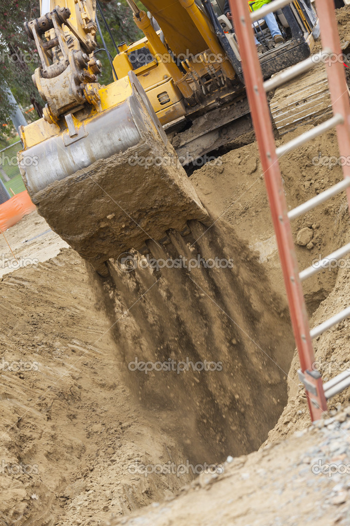 Working Excavator Tractor Digging A Trench.  Stock Photo #21263429