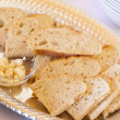 Tray of Fresh Made Sourdough Bread with Garlic Cloves - Stock Photo
