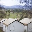 Stock Photo: Safari Tents Overlooking Plains