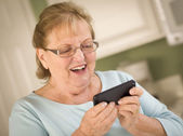 Senior Adult Woman Texting on Smart Cell Phone — Stock Photo