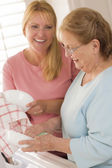 Senior Adult Woman and Young Daughter Talking in Kitchen — Stock Photo