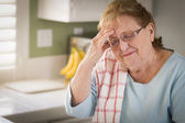 Sad Crying Senior Adult Woman At Kitchen Sink — Stock Photo