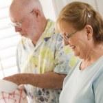 Senior Adult Couple Washing Dishes Together Inside Kitchen — Stock Photo
