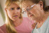 Young Woman Consoles Senior Adult Female — Stock Photo