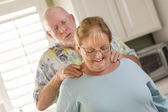 Senior Adult Husband Giving Wife a Shoulder Rub — Stock Photo
