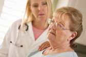 Senior Adult Woman Being Consoled by Female Doctor or Nurse — Stock Photo