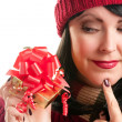 Brunette Woman Holds Holiday Gift — Stock Photo #2343470