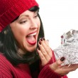 Surprised Woman Holds Holiday Gift — Stock Photo #2343735
