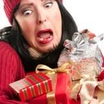 Nervous Woman Balances Many Gifts — Stock Photo #2343782