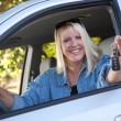 Attractive Woman In New Car with Keys — Stock Photo #2345603