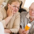 Doctor or Nurse Explaining Prescription Medicine to Senior Coupl — Stock Photo #24076985
