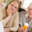 Doctor or Nurse Explaining Prescription Medicine to Senior Coupl — Stock Photo