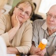 Doctor or Nurse Explaining Prescription Medicine to Senior Coupl — Stock Photo #24077007