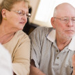 Doctor or Nurse Explaining Prescription Medicine to Senior Coupl - Stock Photo