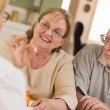 Doctor or Nurse Explaining Prescription Medicine to Senior Coupl — Stock Photo #24077043