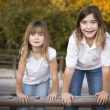 Pretty Young Sisters Portrait Outside - Stock Photo