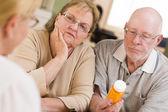 Doctor or Nurse Explaining Prescription Medicine to Senior Coupl — Stock Photo