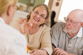 Doctor or Nurse Explaining Prescription Medicine to Senior Coupl — Foto Stock