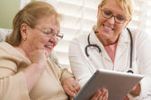 Doctor or Nurse Talking to Senior Woman with Touch Pad — Stock Photo