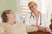 Doctor or Nurse Talking to Sitting Senior Woman — Stock Photo