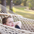 Royalty-Free Stock Photo: Young Boy Enjoying A Day in His Hammock