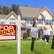 Hispanic Family in Front of Sold Real Estate Sign, House — Stockfoto