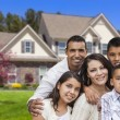Stock Photo: Hispanic Family in Front of Beautiful House