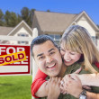 Couple in Front of Sold Real Estate Sign and House — Stock Photo #24176847