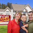 Family in Front of Sold Real Estate Sign and House — Stock Photo