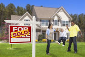 Hispanic Family in Front of Sold Real Estate Sign, House — Stock Photo