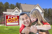 Couple in Front of Sold Real Estate Sign and House — Stock Photo