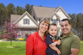 Mixed Race Young Family in Front of House — Stock Photo