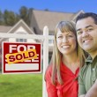 Couple in Front of Sold Real Estate Sign and House — Stock Photo #24281193