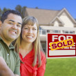 Couple in Front of Sold Real Estate Sign and House — Stock Photo #24281203