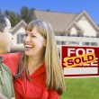 Couple in Front of Sold Real Estate Sign and House — 图库照片