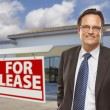 Stock Photo: Businessman In Front of Office Building and For Lease Sign