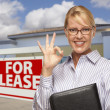 Stock Photo: Businesswoman In Front of Office Building and For Lease Sign