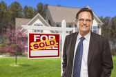 Male Real Estate Agent in Front of Sold Sign and House — Stockfoto