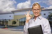 Businesswoman In Front of Vacant Office Building — Stock Photo