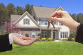 Agent Handing Over the House Keys in Front of New Home — Stok fotoğraf
