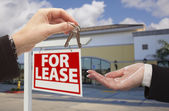 Handing Over Keys in Front of Business Office and Sign — Stock Photo