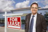 Businessman In Front of Office Building and For Lease Sign — Stock Photo
