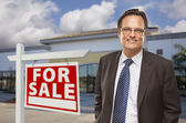 Businessman In Front of Office Building and For Sale Sign — Stock Photo