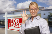 Businesswoman In Front of Office Building and For Lease Sign — Stock Photo