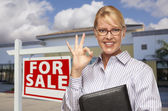 Businesswoman In Front of Office Building and For Sale Sign — Stock Photo