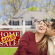 Couple in Front of Sold Real Estate Sign and House — Stock Photo #24418267