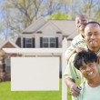 African American Family In Front of Blank Real Estate Sign and H — Stock Photo