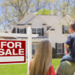 Stock Photo: Family Facing For Sale Real Estate Sign and House