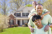 African American Family In Front of Beautiful House — Stock Photo